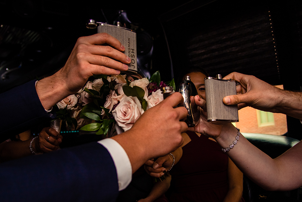 Bridal party toasting in the limo back to the Omni Shoreham Hotel by DC wedding photographers Potok's World Photography
