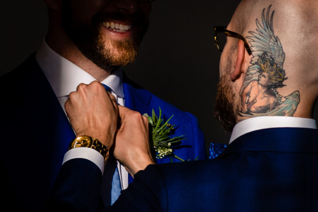 Two grooms getting ready at the Conrad Hotel before their intimate wedding ceremony by Potok's World Photography