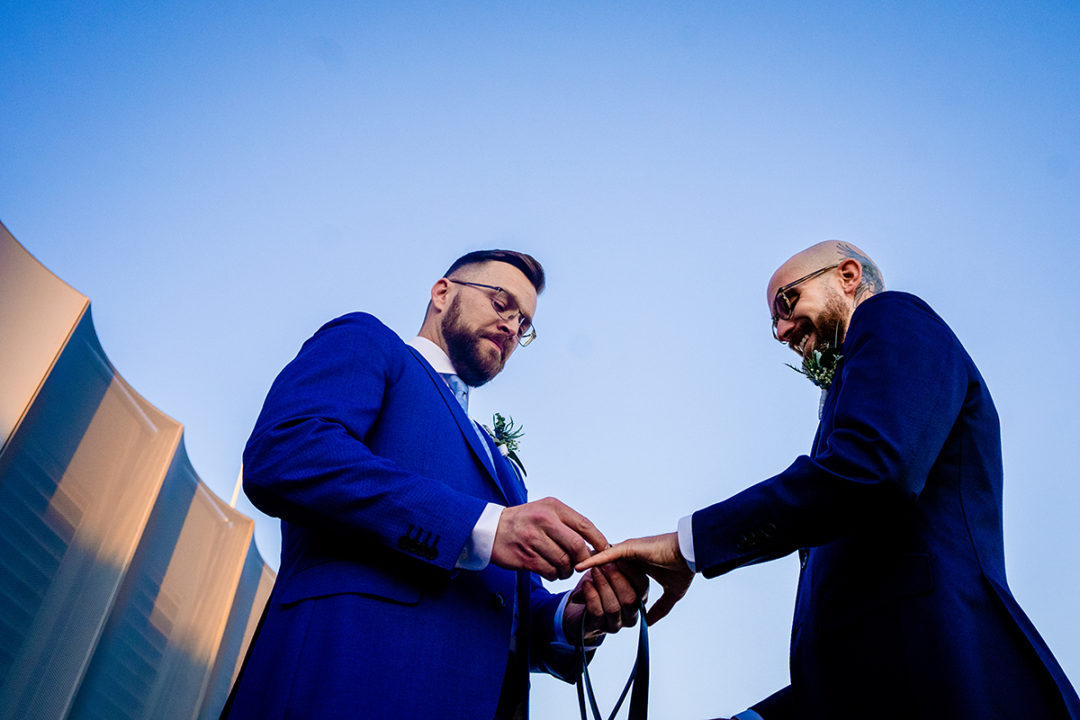 Ring exchange at intimate same sex wedding at the Conrad Hotel DC by Potok's World Photography