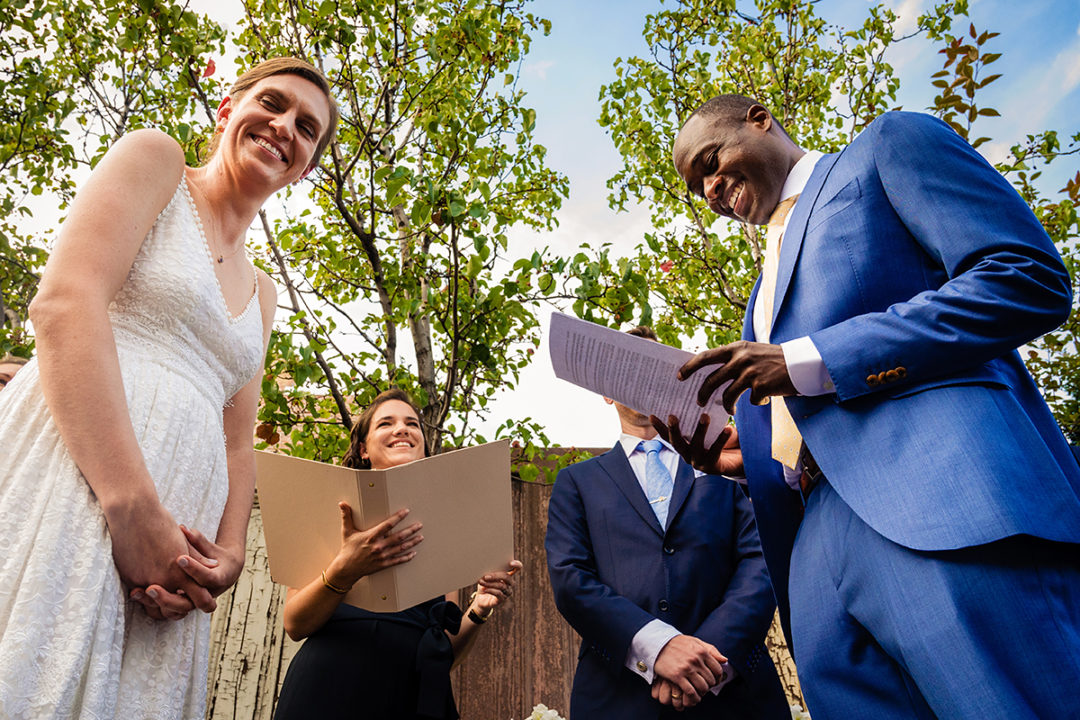 Couple exchanging vows at outdoor wedding ceremony at Fathom Gallery in DC by Potok's World Photography