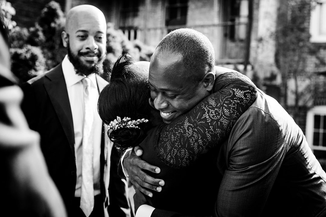 Mom and groom moment at Fathom Gallery DC outdoor ceremony by Potok's World Photography